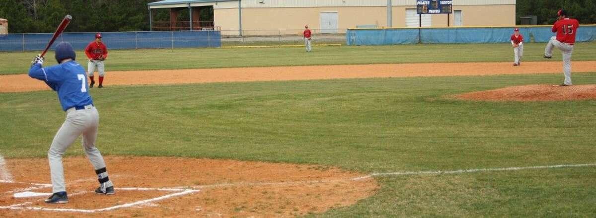 Alex Aguilar (15) prepares to pitch a fastball to Pirate Cody Crowder (7).
