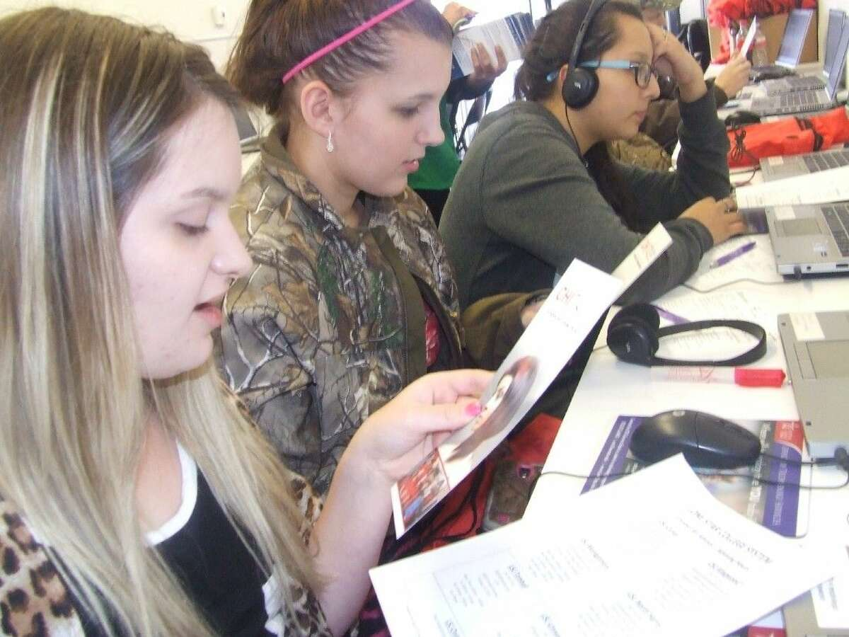 Juniors at Alpha Academy Chaslin Holbert and Faith Leach along with sophomore Perla Mendoza visits the Mobile Go Center on Tuesday, Feb. 24.