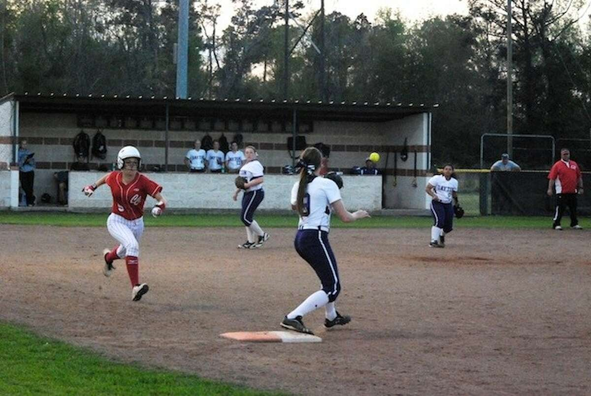 Shelbie Robbis throws to first for an out on Crosby's Amanda McMahan. Robbins made three assists in the game.