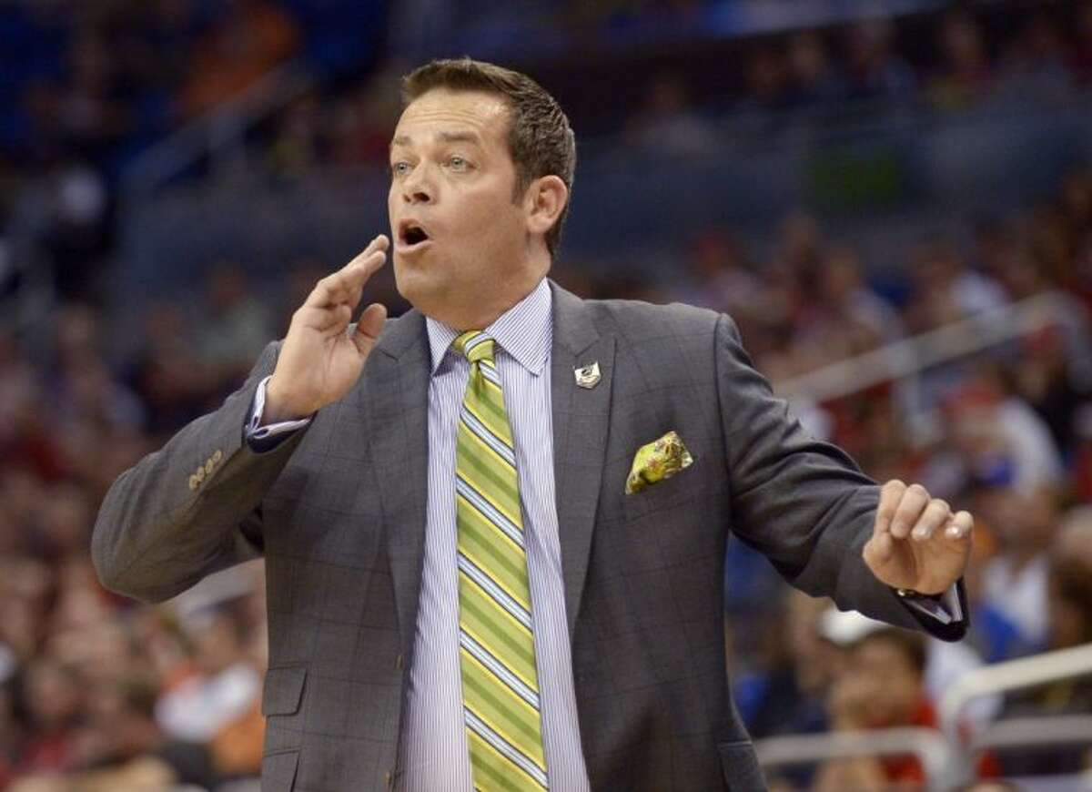 Manhattan coach Steve Masiello yells at his team during the first half against Louisville in a second-round game in the NCAA tournament on Thursday in Orlando, Fla.