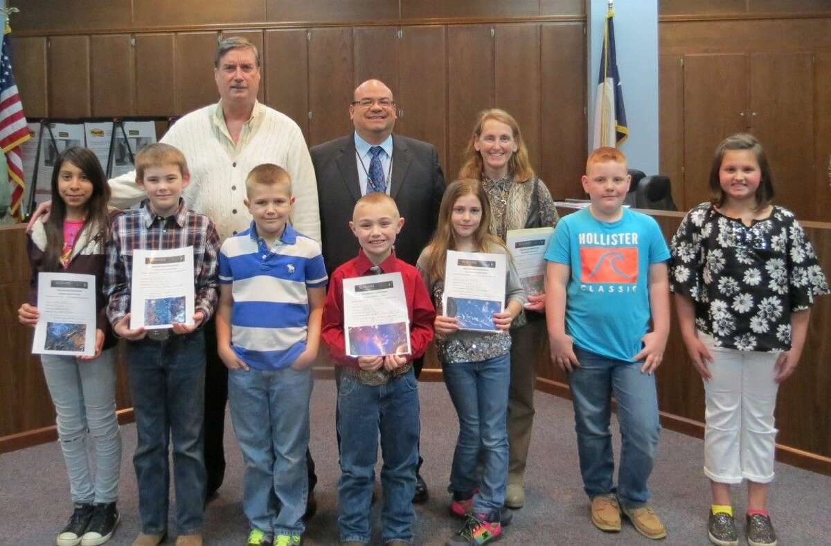 Shepherd students participated in the Sally Ride EarthKAM outreach program. They were recognized at the Feb. 16 meeting of the Shepherd ISD Board of Trustees. Pictured are (front row, left to right) Arelis Garcia, Cole Russell, Hunter Goodman, Garrett Burton, Savannah Lowrance, Drew Hodge, Makenna Pierce; (back row) Jack Cowen, fifth grade science teacher; Mark Silva, principal; and Adrian Cennamo, third grade science teacher.