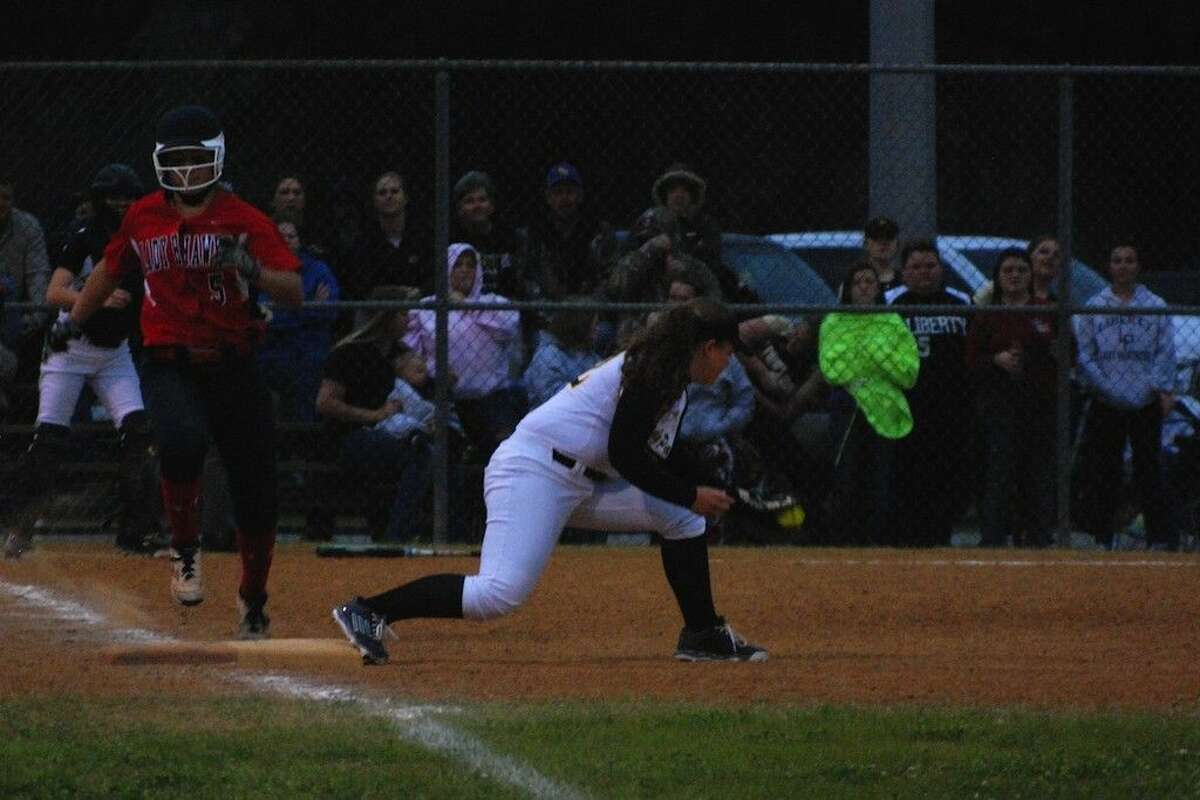 As the sun went down in the seventh inning, the Lady Hawks' Caroline Spacek connected for a grounder to third, but she was put out at first, Katie Harris to Lizzie Harris, and the Lady Panthers took the game, 7-3, Friday, Feb. 20, 2015, at Liberty.