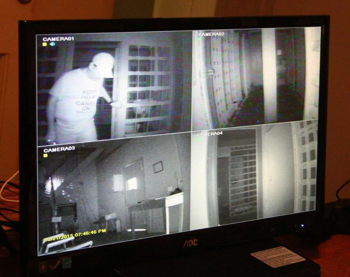 The South Texas Afterlife Researchers use cameras to watch for orbs, which they describe as a form of spiritual energy and can be confused with dust particles. In the top left, team member Phillip Alvarez inspects the various rooms inside of the Old Jail Museum.