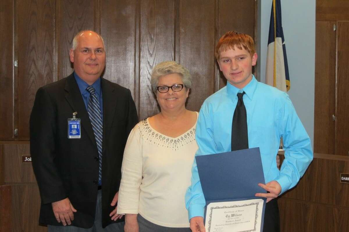 Shepherd Jr. High honored seventh grade student Ty Wilson. He is a member of the National Jr. Honor Society, Vice President of the Student Council, is a member of the A Honor Roll and participates in athletics and 4-H. From left to right are Superintendent Steve Pierce, Jr. High Principal Brenda Cronin and Wilson.
