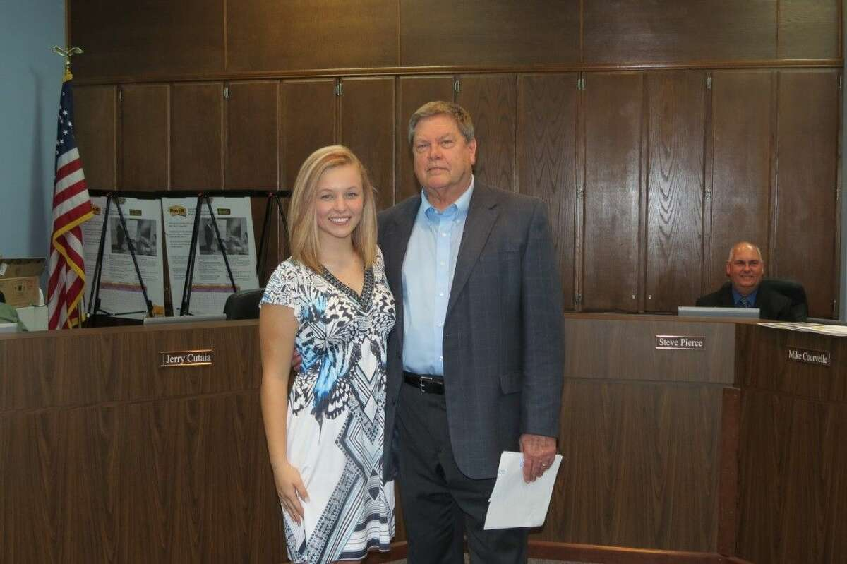 Cheyenne Pope (left) stands next to Shepherd High School Principal Jimmy Meeks as she is honored before the Shepherd ISD school board on Feb. 16. She is a member of the National Honors Society and participates in cheerleading, FFA, golf and band. She has been part of All Area Band for three years and All State Band in 2014.