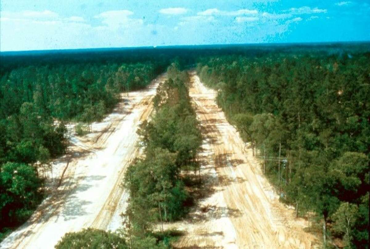This file photo from 1974 shows the cleared land for Woodlands Parkway.
