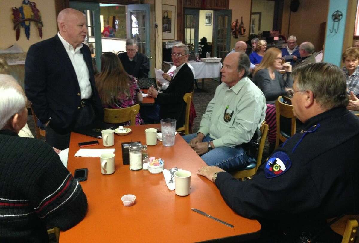 Congressman Kevin Brady (second from left) engages in small talk with San Jacinto County Chief Deputy Joe Schultea (right) and Pct. 3 Constable Sam Houston.