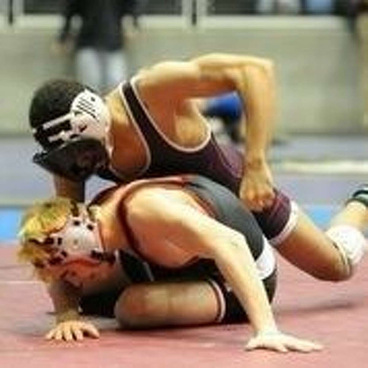 Mujahid Ewell (top) earned a silver medal at the UIL state wrestling meet in the 132-pound division. He advanced to the state finals before falling to El Dorado's Jeremy Melendez.
