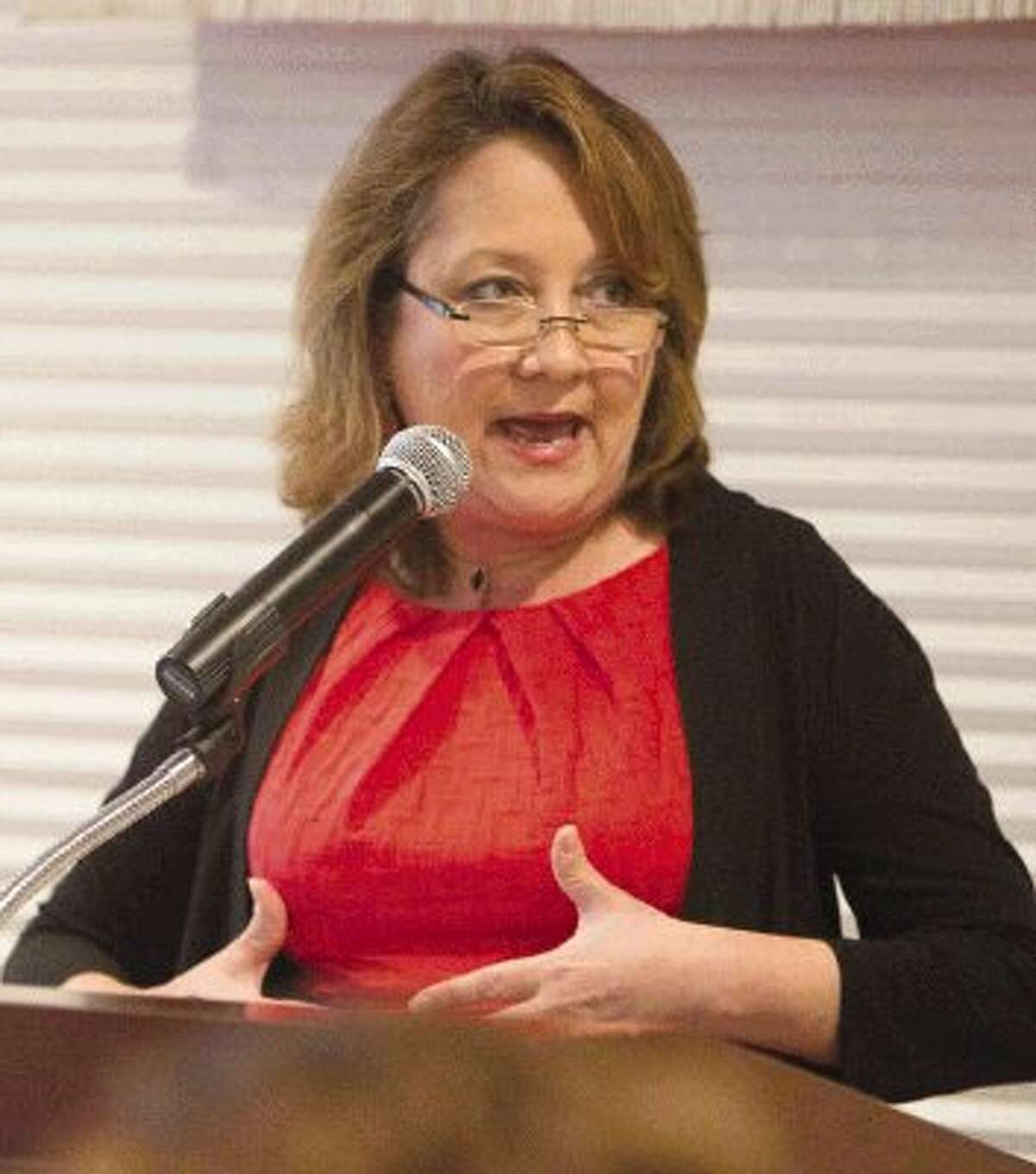 Cecilia Abbott, wife of Attorney General and gubernatorial candidate Greg Abbott, speaks at the Montgomery County Republican Women's monthly luncheon Thursday.