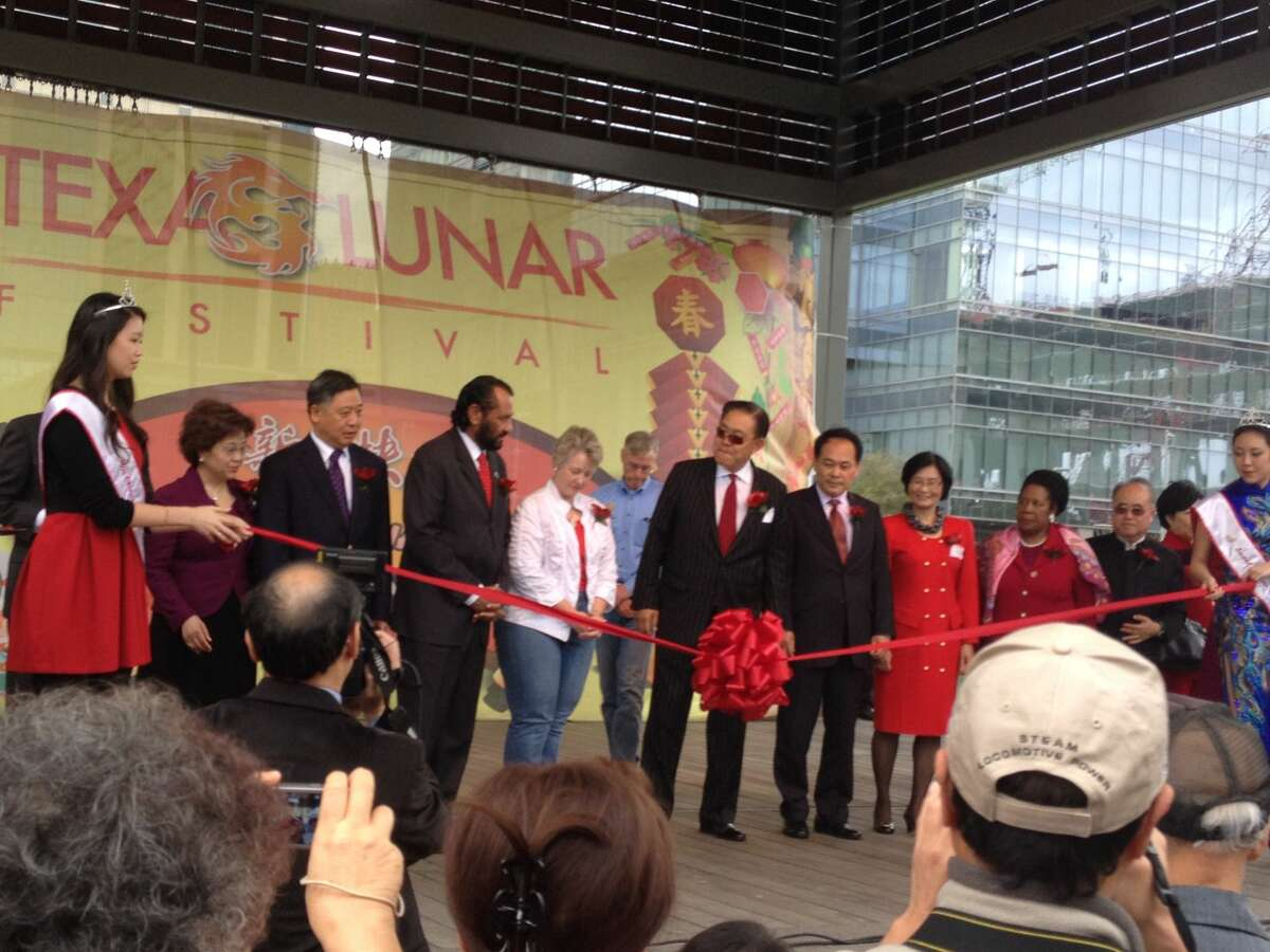 Houston Mayor Annise Parker, Congressman Al Green, Rep. Sheila Jackson Lee, and Festival Chairman Wea H. Lee cut the ceremonial ribbon at the 19th Annual Texas Lunar Festival at Discovery Green on Feb. 21, 2015.