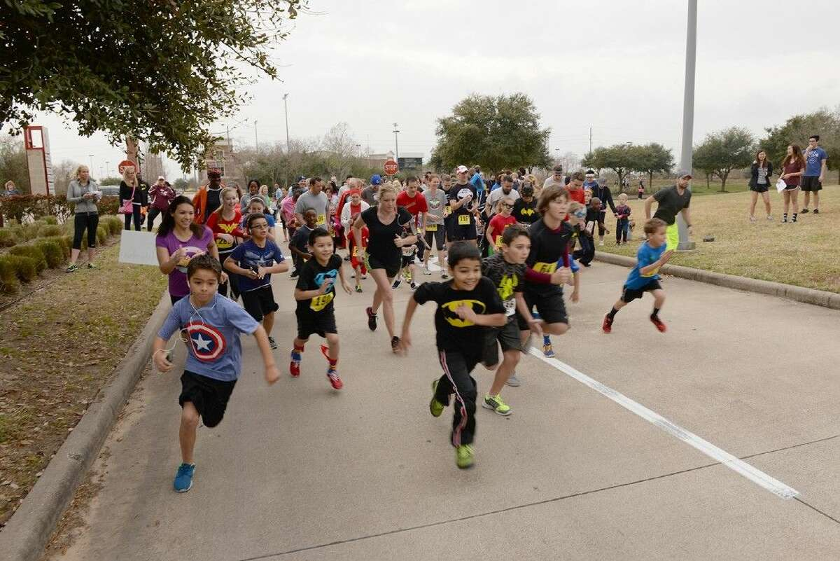 Children lead the way at the beginning of the 1-mile run during the second annual Superintendent Fun Run on Feb. 21.