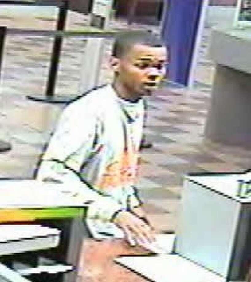 Bank surveillance photo of one suspect. Photo: Courtesy FBI