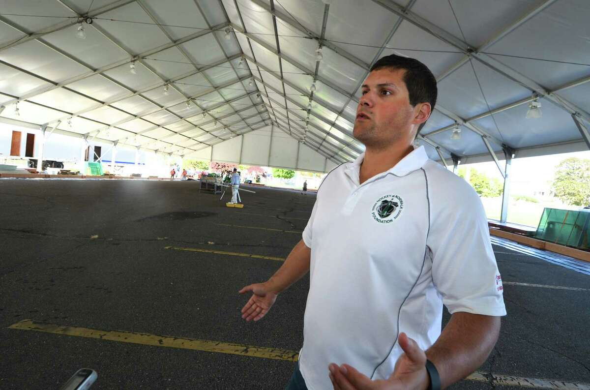 Ryan Hughes President and Co Founder of SONO Ice House and President of North American Rink Builders talks about the progress being made on the installation of two regulation size ice rinks under the tent at Veterans Park on Monday October 3, 2016 in Norwalk Conn. The seasonal structure measures 100 X 400 Ft. The ice will be kept frozen by an electric chiller that will keep it at 21 degrees.
