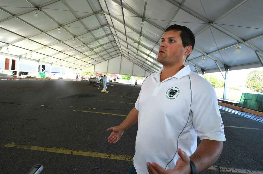 Ryan Hughes President and Co Founder of SONO Ice House and President of North American Rink Builders talks about the progress being made on the installation of two regulation size ice rinks under the tent at Veterans Park on Monday October 3, 2016 in Norwalk Conn. The seasonal structure measures 100 X 400 Ft. The ice will be kept frozen by an electric chiller that will keep it at 21 degrees. Photo: Alex Von Kleydorff / Hearst Connecticut Media / Connecticut Post