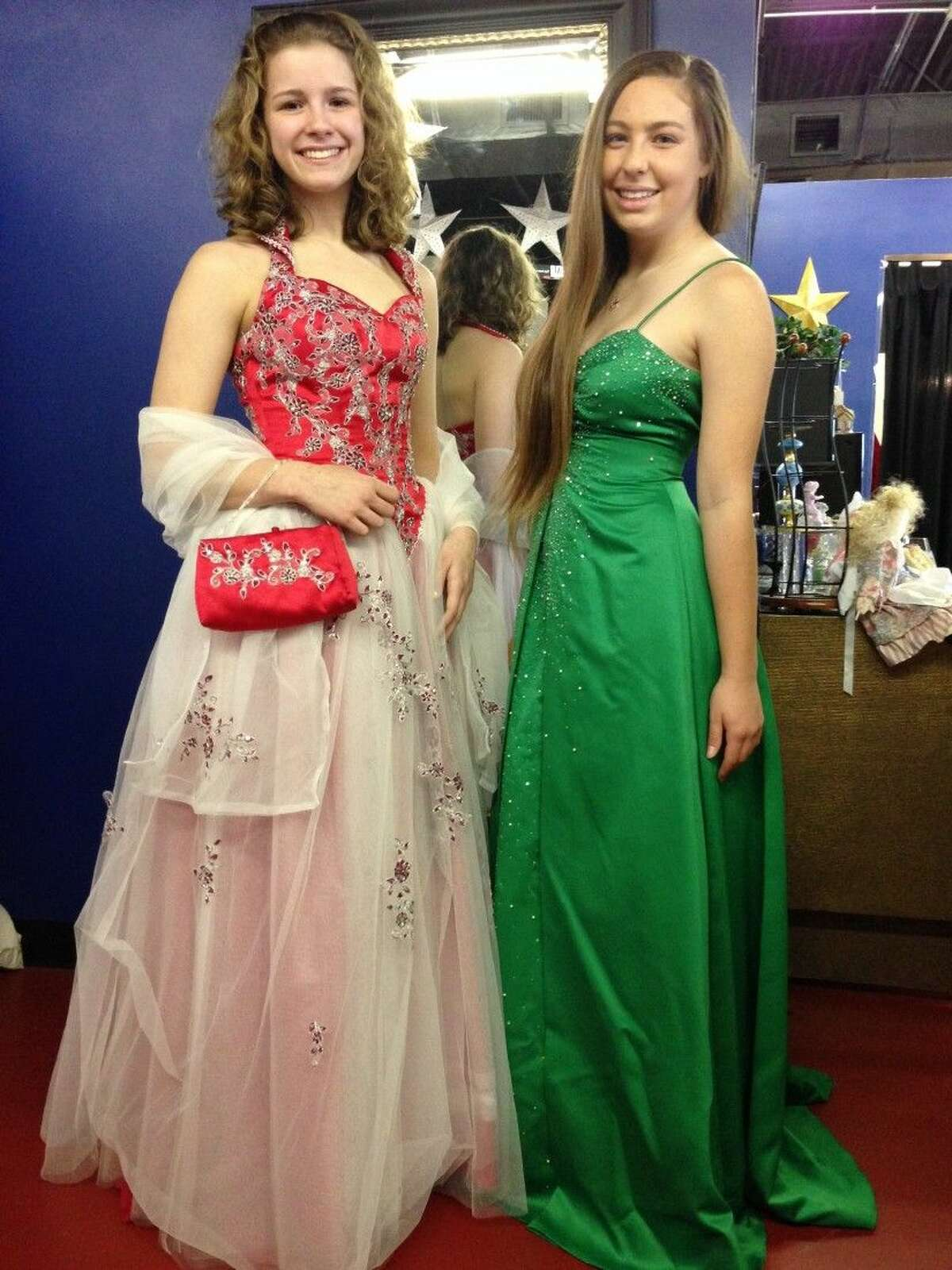 Two lovely Assisteens® model dresses from Operation Cinderella's robust collection of formal evening dresses. Assisteens are an auxiliary to Assistance League made up of over 200 local high school students.