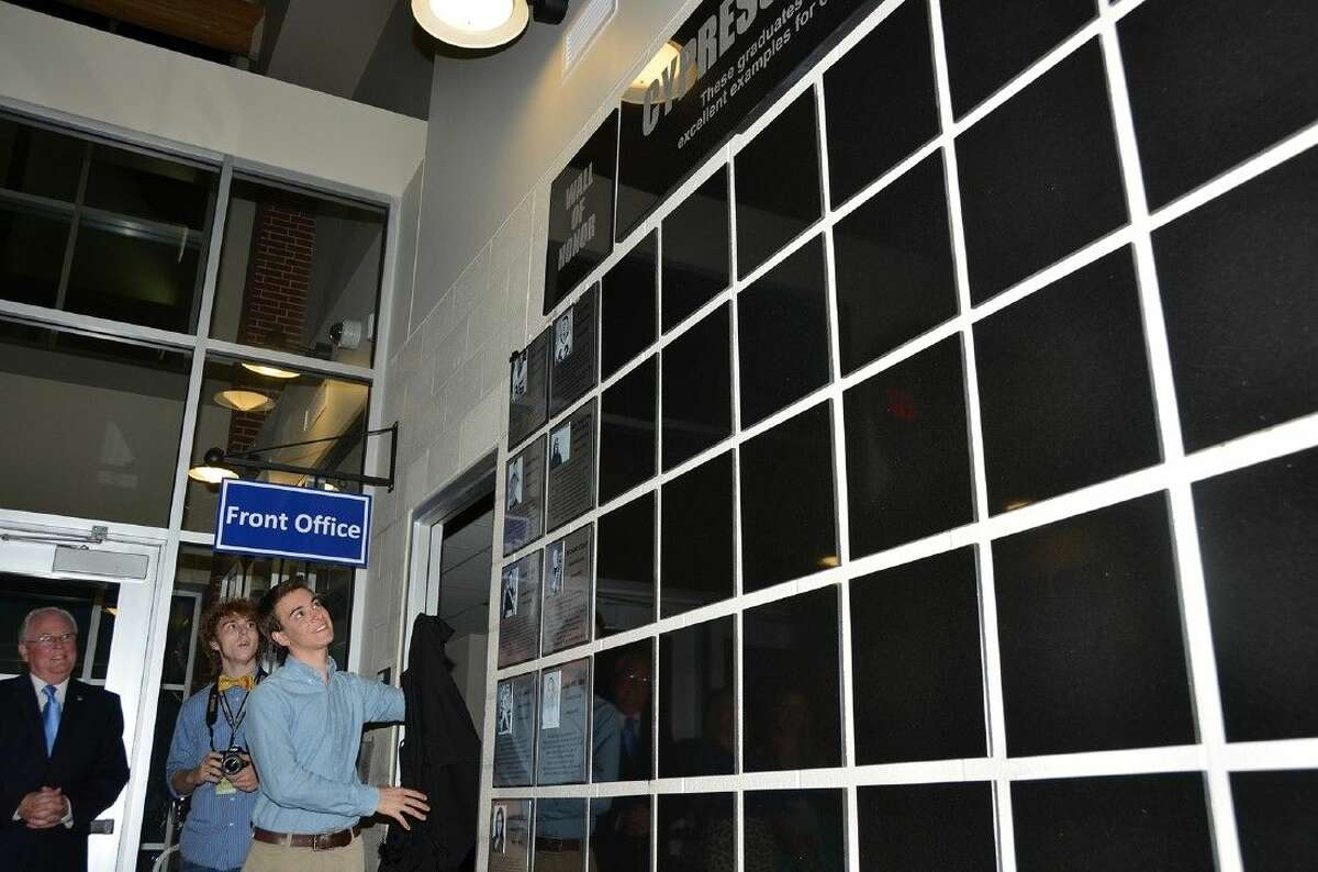 The Wall of Honor is unveiled at Cypress Creek High School in March 2013.