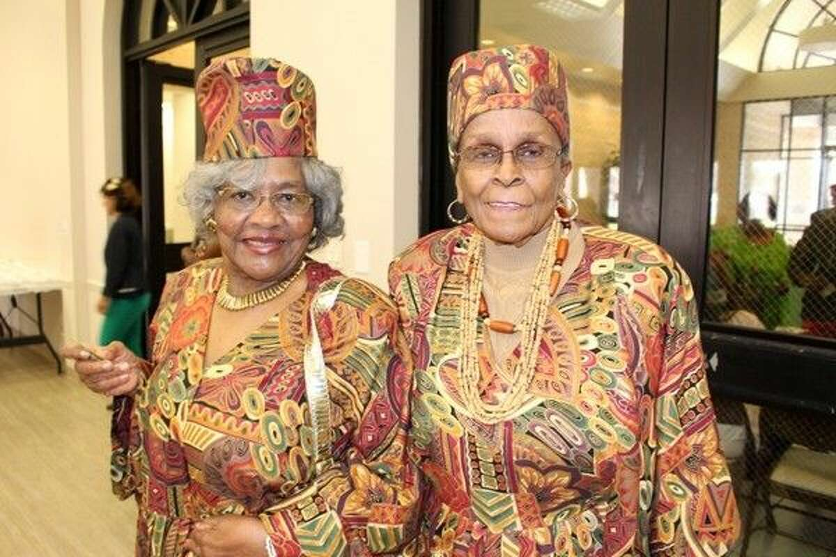 Toyce Humphrey and Joyce Thomas wear traditional African garb during the Black History Awareness luncheon at Mangum-Howell in Precinct 4.