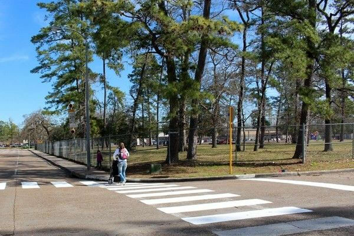 A family crosses a freshly painted crosswalk at Reynaldo and Ludgate drives in Harris County Precinct 4.