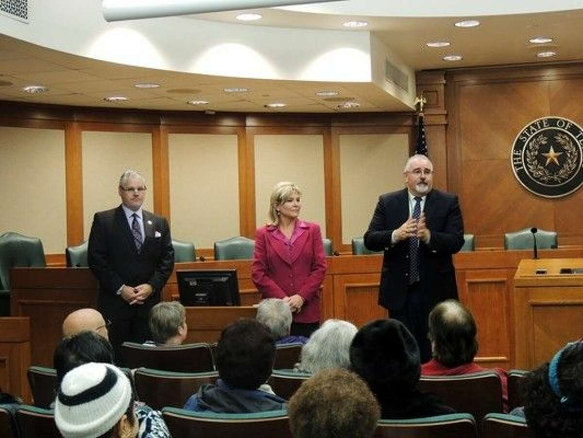 Representatives Dan Huberty and Patricia Harless with Commissioner R. Jack Cagle speak with residents about current legislation affecting them.