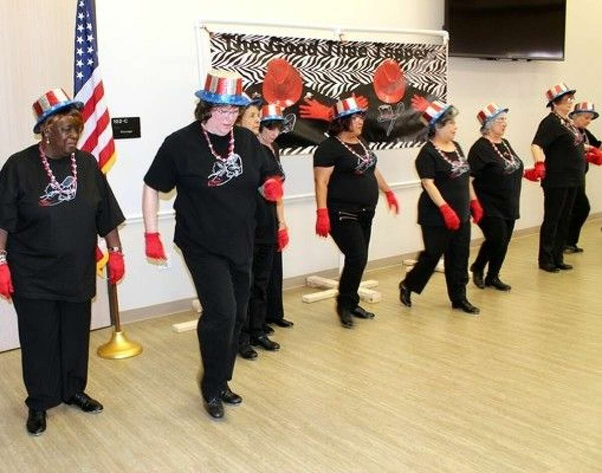 The Good Time Tappers perform at Mangum-Howell Center in Precinct 4.