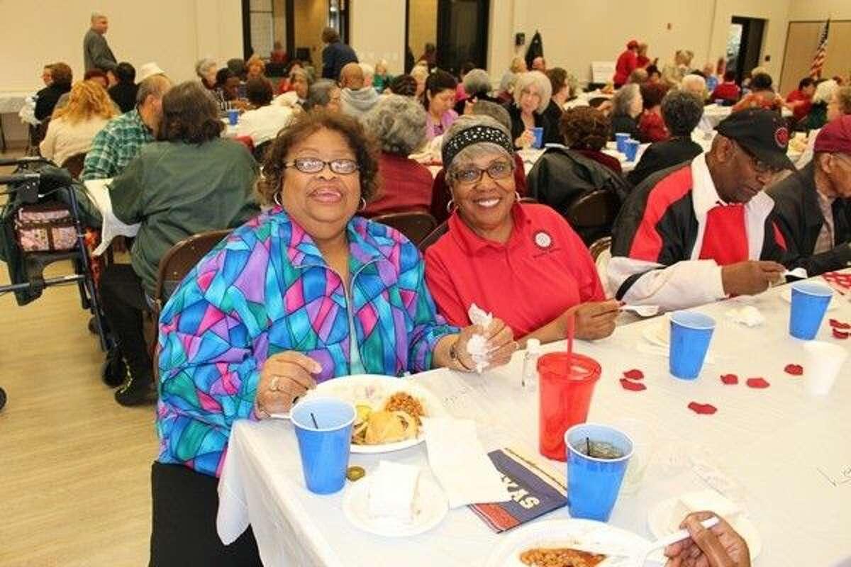 Linda Watkins and Marine Jones enjoy lunch at Precinct 4's Mangum-Howell Center.