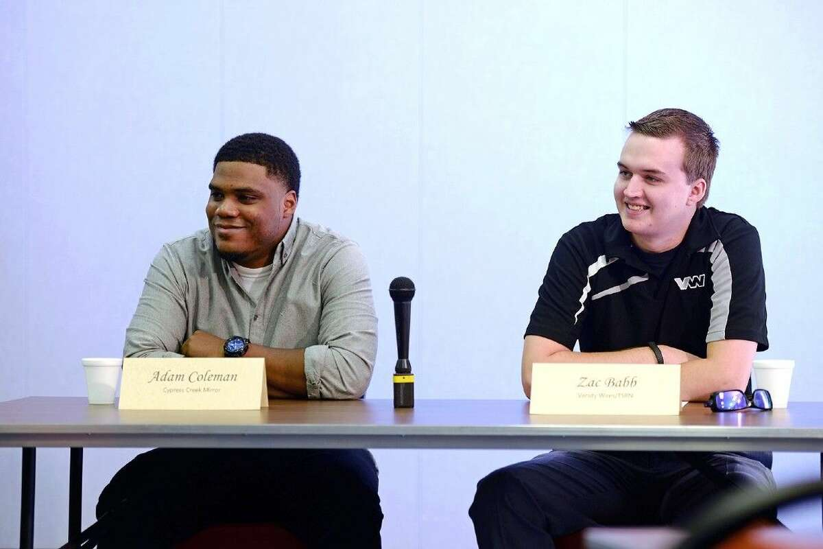 Local sports media members Adam Coleman of the Cypress Creek Mirror, left, and Zac Babb of Varsity Wires field questions from student reporters during the communication department's monthly press conference on Feb. 12 in the professional library of CFISD's Instructional Support Center.