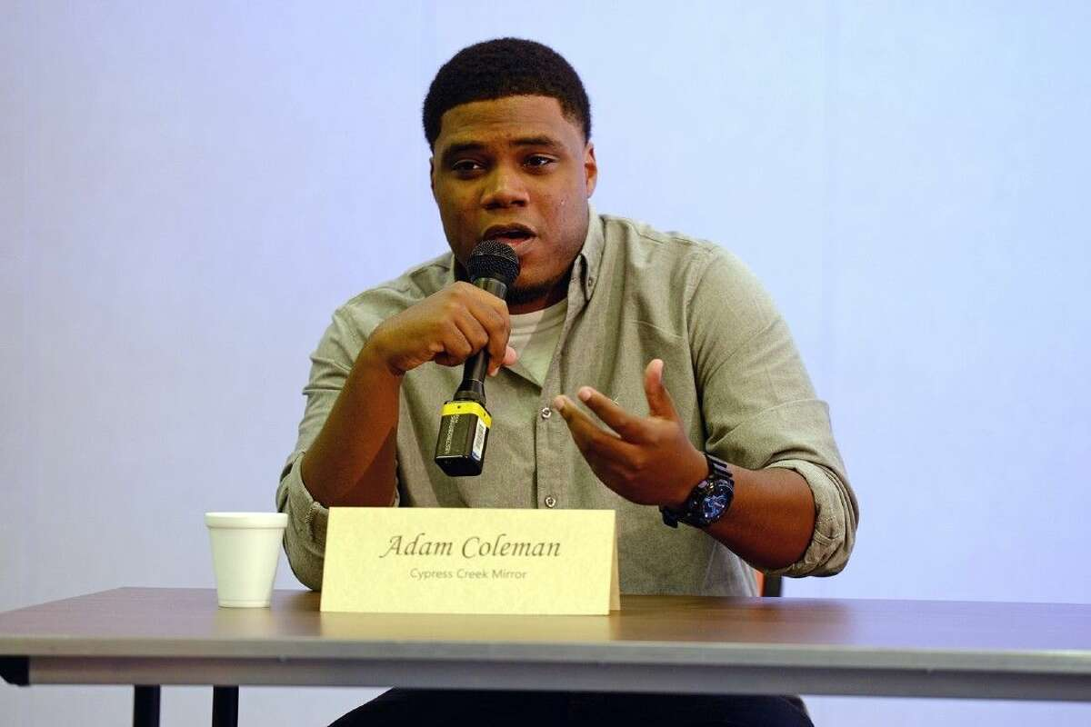 Adam Coleman, sports editor of the Cypress Creek Mirror, responds to a question during the Feb. 12 press conference.