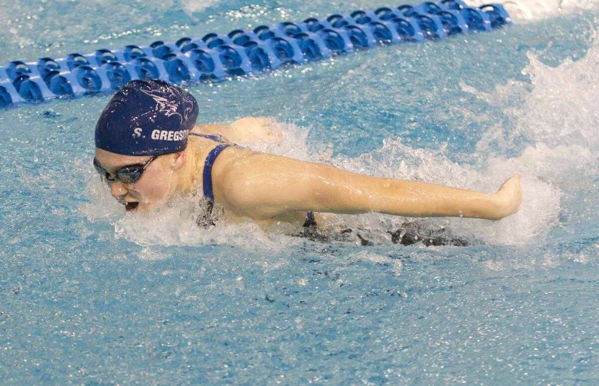 Tomball Memorial's Shea Gregson competes in the girls 100-yard butterfly during the prelims of the Class 5A UIL State Swimming & Diving Championships in Austin Friday, Feb. 20, 2015. Go to HCNpics.com to view more photos from the event.