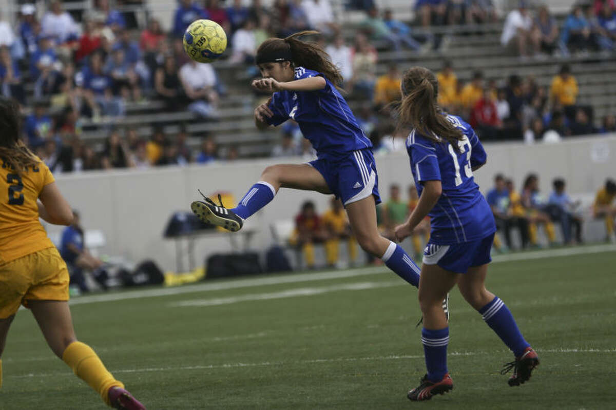 Cy Creek's Kat Shoffner (5) shoots for the goal during the girls' soccer game against Nimitz on Friday at Thorne Stadium. To view or purchase this photo and others like it, go to HCNPics.com. (Michael Minasi / HCN)