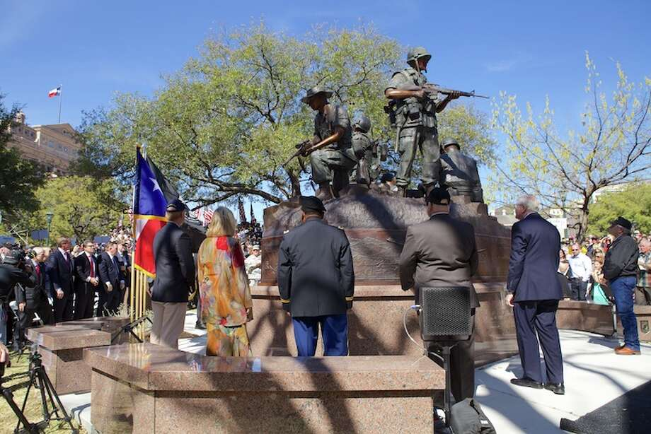 Gov. Rick Perry today paid tribute to Texas veterans who served or gave their lives in the Vietnam War at the unveiling and dedication of the Vietnam Veterans Monument on the Texas State Capitol Grounds. The ceremony was held on Texas Vietnam Veterans Day, which marks the anniversary of the day the last American combat troops left Vietnam.  Photo: Governor's Press Office