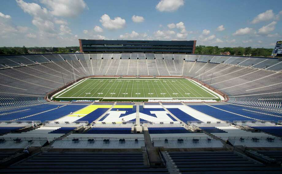 """The University of Michigan Wolverines play in the """"Big House,"""" a 100,000-plus-seat stadium. Photo: Paul Sancya, STF / AP"""