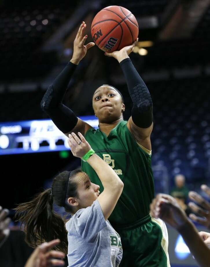 Baylor Bears guard Odyssey Sims shoots over a teammate during practice for today's game against Kentucky in the NCAA women's tournament.