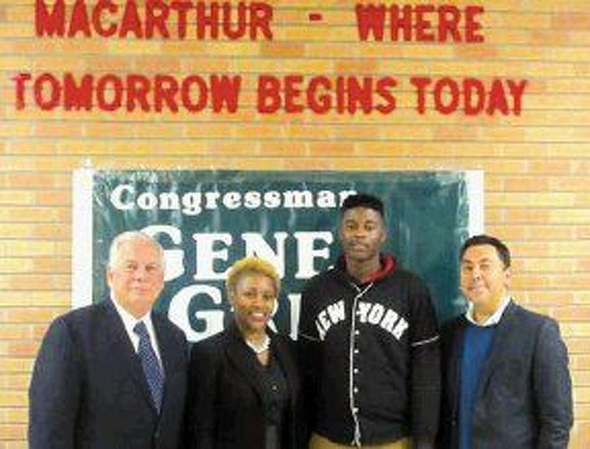 From left to right: Congressman Gene Green; Marva Flentroy, counselor at MacArthur Senior High; Markques Houston, scholarship winner and Sergio Gonzalez, representative from The Sallie Mae Fund.