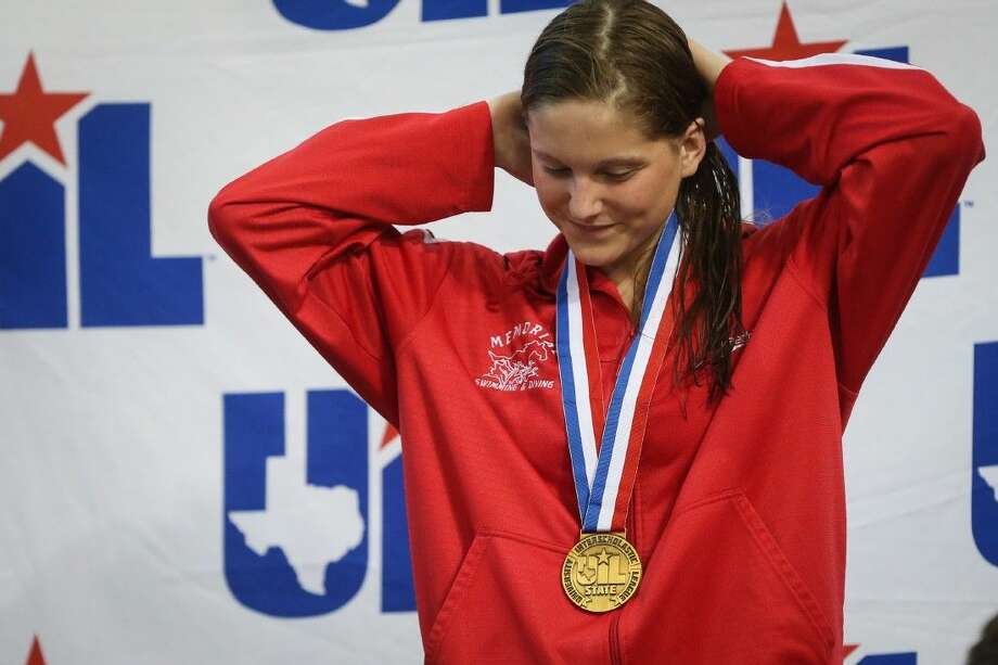Memorial's Alexandra Buscher is awarded 3rd place in 200-yard freestyle during the 6A UIL State Swimming and Diving Championships on Saturday, Feb. 21, 2015, at the Lee and Joe Jamail Texas Swimming Center in Austin. To view more photos from the tournament, check out the photo galleries on HCNPics.com. Photo: Michael Minasi