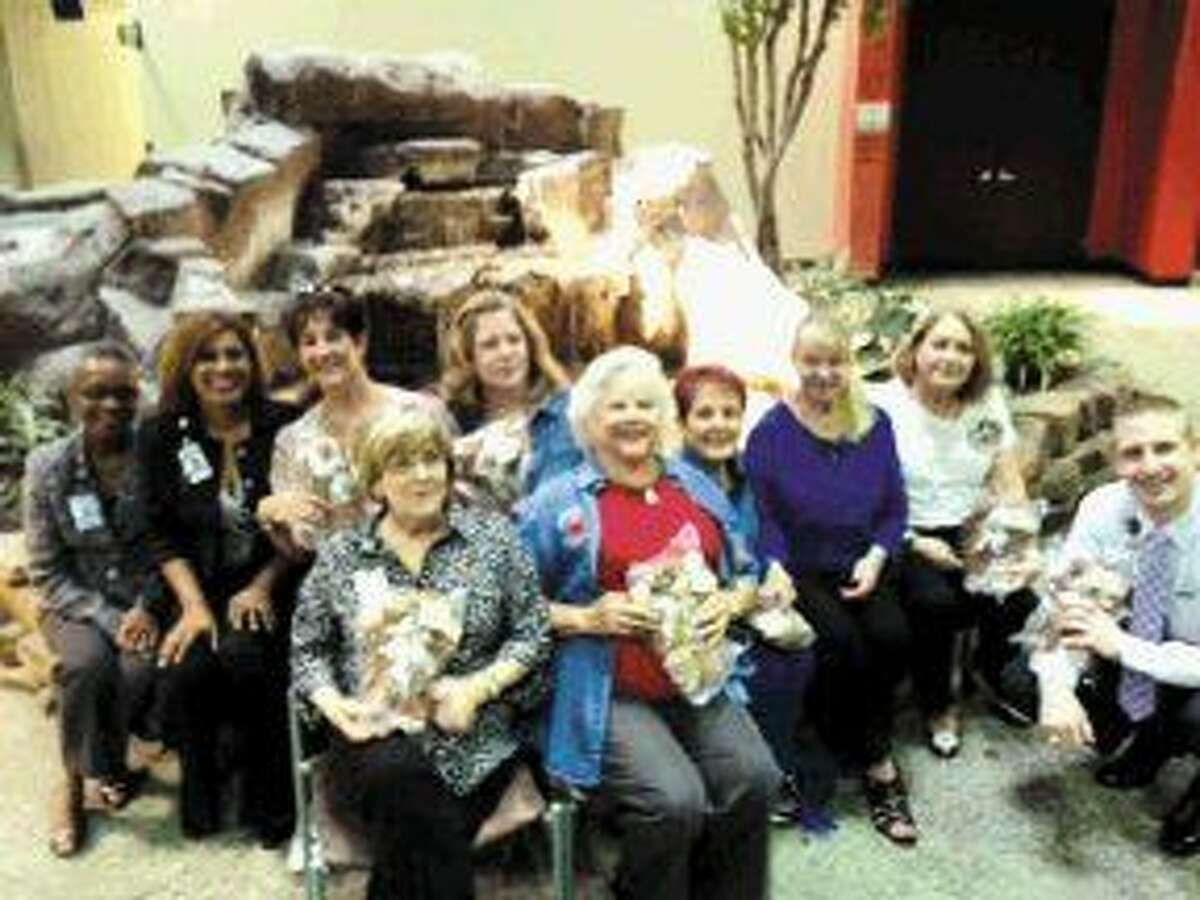 Pictured in the back row, gifting to the Kingwood Medical Center from left to right are Carole White-Clarence, director of education at Kingwood Medical Center; Dianne Crosley, director of business development; Heartbeat Bear members: Jill Smith, Aimee Papacostas, P.V. Fitzharris, Marilyn Butler, Victoria Ramirez and Kevin Scoggin, assistant administrator of the hospital. Pictured in the front row are Rose Ann Martin, education manager and Ruthann Koza, chairbear of the Kingwood Heartbeat Bears.