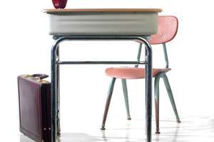 Times Union staff photo by Lori Van Buren -- Photo of school desk, chair, apple and briedcase for illustration about fathers and teachers on August 30, 2006.