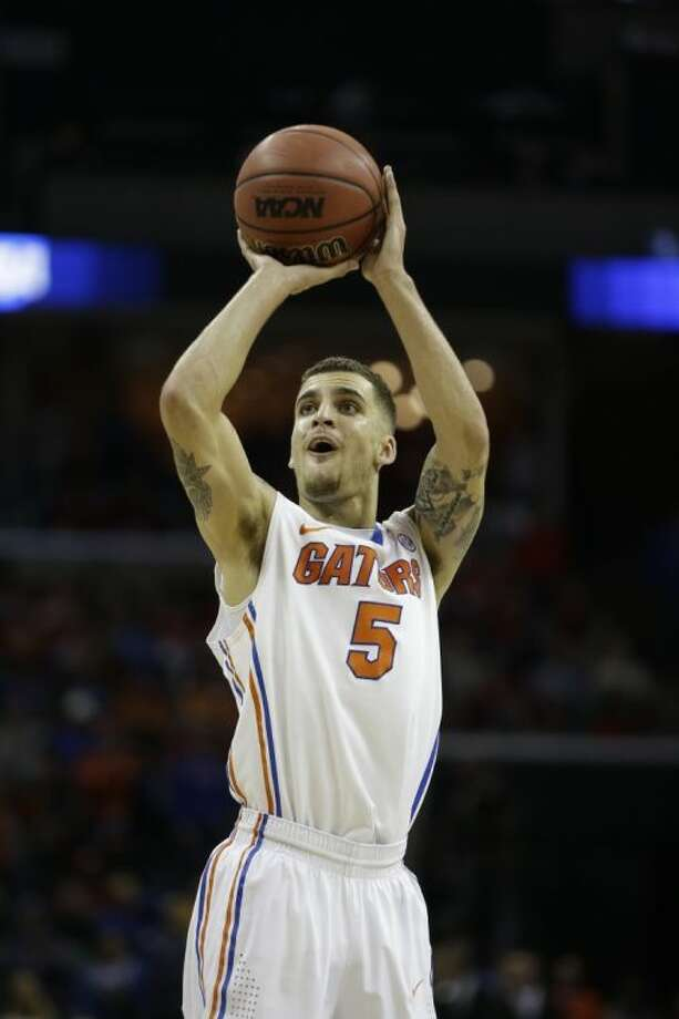 Florida guard Scottie Wilbekin shoots against Dayton during the first half in a regional final game. Florida won 62-52 to reach the Final Four.