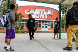 (l-r) Students Fabian Mendoza, Brian Romero and Sergio Ledezma stand outside during lunch, at Castlemont High School, in Oakland, California, on Monday, Oct. 3, 2016.