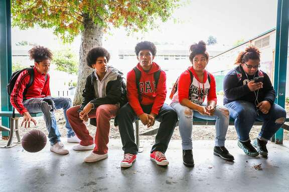 (l-r) Students Stone Fatai, Mete Feaomoeatra, Tupou Katao, Tapaita Manoa, and Jessi Katoa sit outside during lunch, at Castlemont High School, in Oakland, California, on Monday, Oct. 3, 2016.