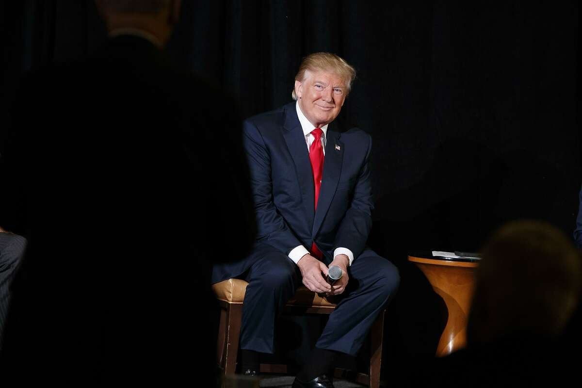 Republican presidential candidate Donald Trump listens to a question during a town hall with the Retired American Warriors, Monday, Oct. 3, 2016, in Herndon, Va. (AP Photo/ Evan Vucci)