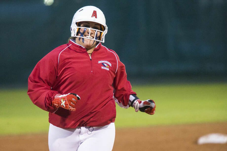 Eagles baserunner Kandace Johnson reacts after hitting an home run over the fence during Atascocita's 13-0 victory over College Park on Feb. 24, 2015, at Atascocita High School.