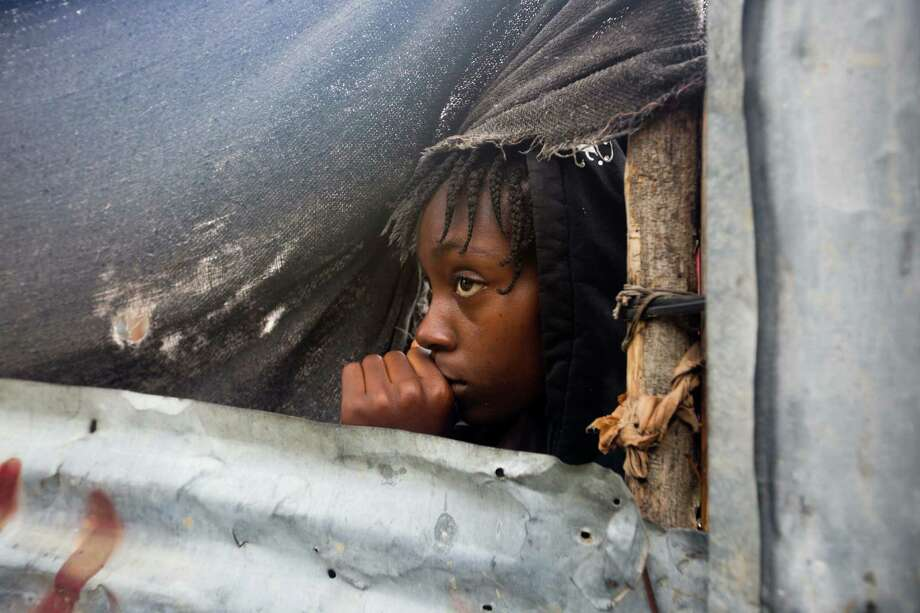 A girl watches as authorities arrive to evacuate people from her house in Tabarre, Haiti, on Monday. The center of Hurricane Matthew is expected to pass near or over southwestern Haiti on Tuesday. Two deaths were reported in Haiti. Photo: Dieu Nalio Chery, STR / Copyright 2016 The Associated Press. All rights reserved.