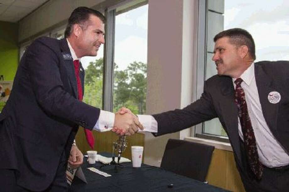"Woodlands Chamber of Commerce member Richard ""Gordy"" Bunch and former State Senator Michael Galloway shake hands after participating in a political forum for candidates vying for the State Senate District 4 seat Tuesday afternoon at the Sam Houston State University The Woodlands Center campus. State House District 16 Rep. Brandon Creighton (R-Conroe) also candidate, also participated in the forum. Photo: Staff Photo By Ana Ramirez / The Conroe Courier/ The Woodland"