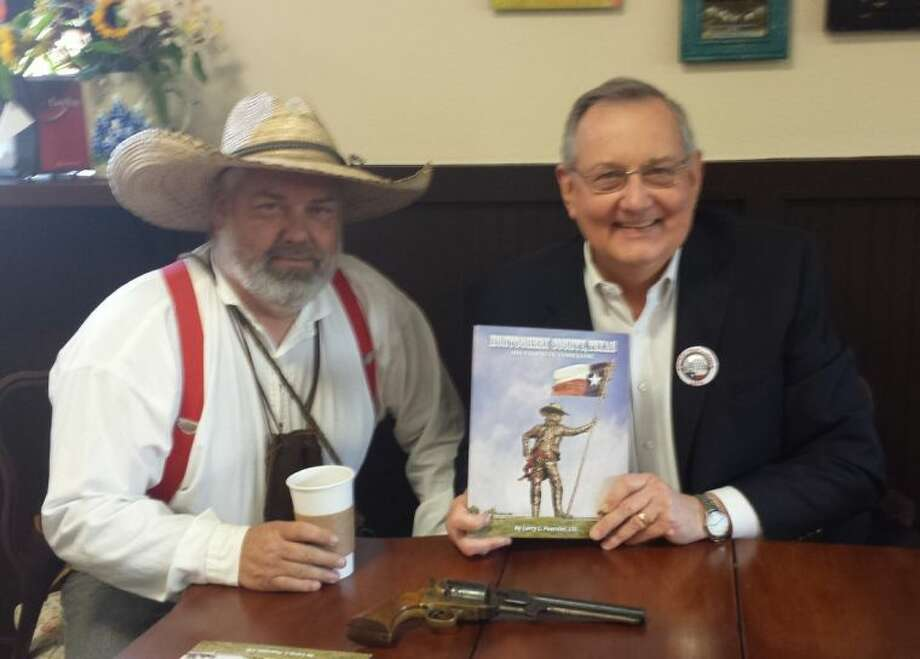 East Montgomery County Historical Society President Jerry Gay attended the book signing, held at Buster's Brew in New Caney. During the event, Larry Foerster signed his new Montgomery County timeline book.