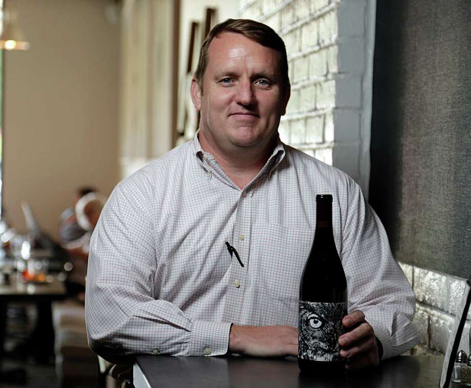 Brendon Fetzer poses for a portrait with a bottle of PARA MARIA de los tecolotes 2014 Red Wine Santa Barbara County at Wood Bar Aug. 4, 2016, in Houston. ( James Nielsen / Houston Chronicle ) Photo: James Nielsen, Staff / © 2016  Houston Chronicle