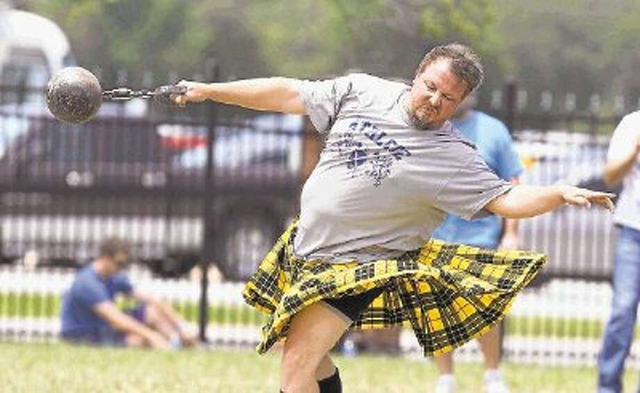 Nathan Schroedter of El Campo in the stone toss at the 2013 Houston Celtic Festival and Highland Games. This year's festival is April 26-27 at the Houston Farm and Ranch Club in northwest Houston. Photo: Alan Warren / @WireImgId=2625232