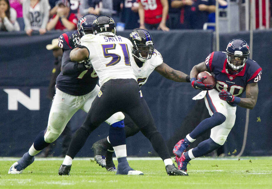 Houston Texans wide receiver Andre Johnson makes his 1,000 career reception in the second quarter of an NFL football game Sunday, Dec. 21, 2014, in Houston. Johnson became the second fastest wide receiver to reach that milestone. Photo: Jason Fochtman