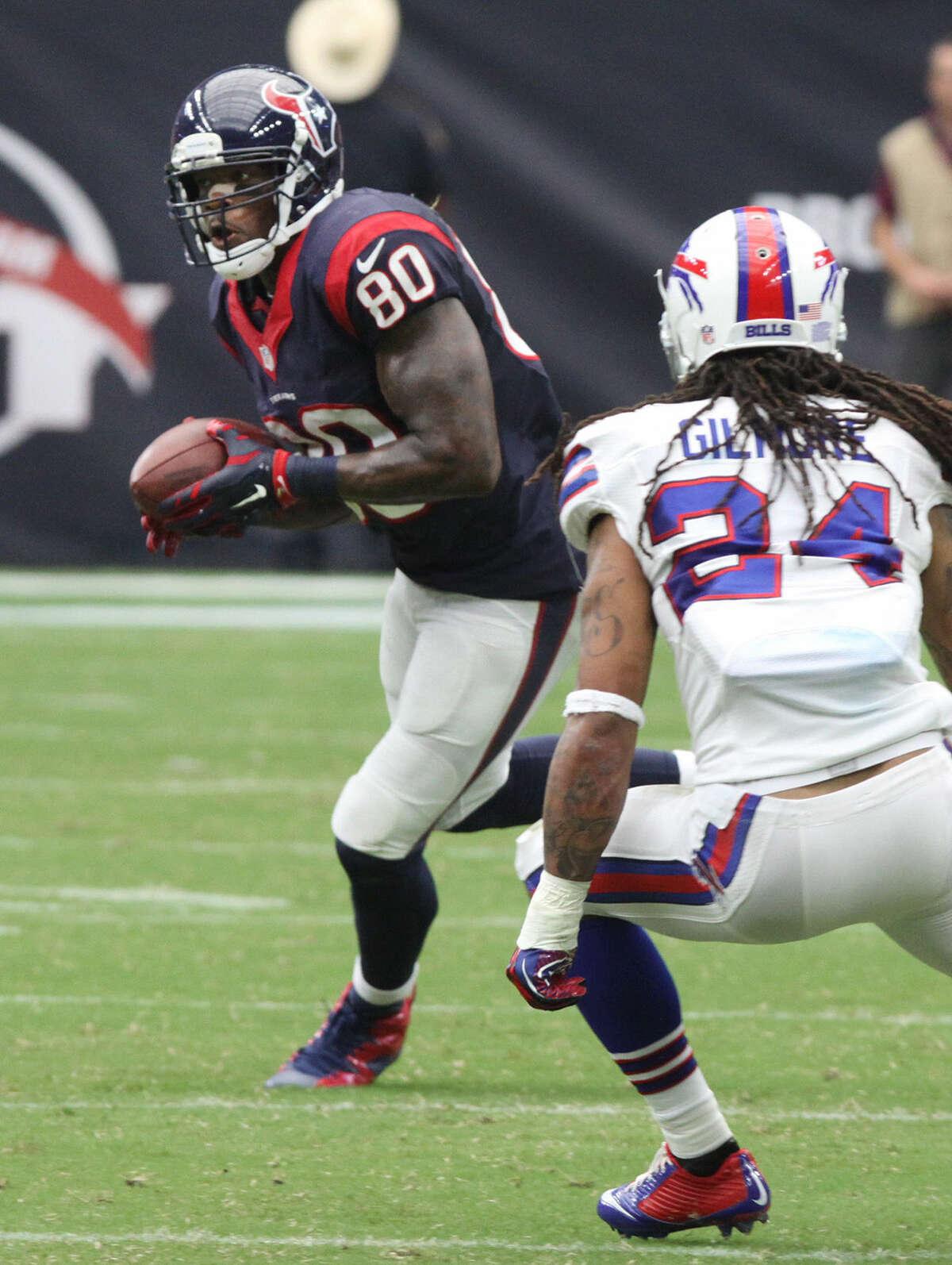 Houston Texans Andre Johnson runs after catch against the Buffalo Bills Stephon Gilmore at NRG Stadium in Houston, Texas on Sunday, September 28, 2014.