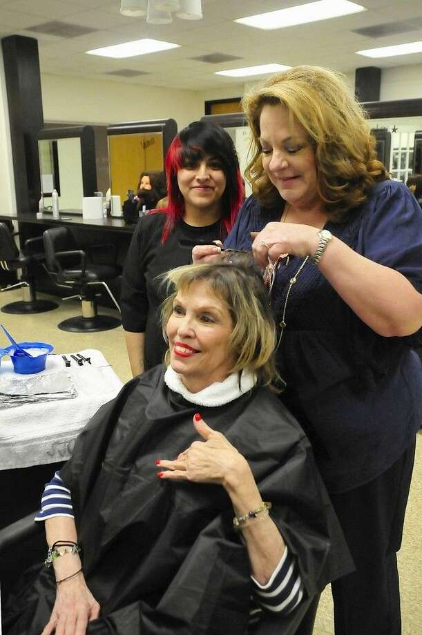 Patricia Holmes, resident of Cedar Bayou Rehabilitation and Healthcare Center, receives a free hair cut and coloring from San Jacinto College student Bertha Martinez (left) and her cosmetology instructor Rita Venable (right). Photo credit: Jeannie Peng-Armao, San Jacinto College marketing, public relations, and government affairs department.