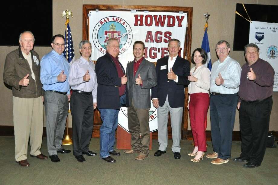 Scott Jarvis, center, Coordinator of A&M Club Programs installs 2015 Bay area A&M Club officers and board members. Pictured from left, Walter Bell, position #2, Mark Sprague, Past President, Leon Coe, Secretary, Randy Elms, President, Scott Jarvis, Installation officer, John Piwonka, Vice President, Meredith Brown, Position #3, Mike Cade Treasurer and Greg Langford, Position #1.